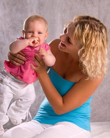 Young Mum With Her Baby Daughter photo