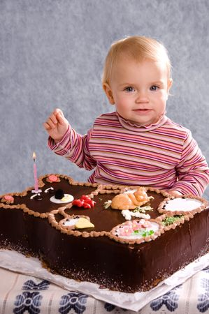 Cute Baby with a Birthday Cake photo