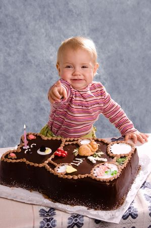 baby girls smiley face: Cute Baby with a Birthday Cake