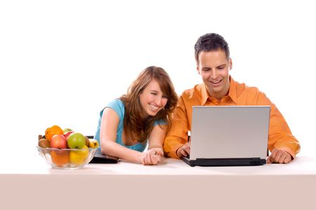 Beautiful Couple are haveing Fun With Laptop. Stock Photo - 3133804