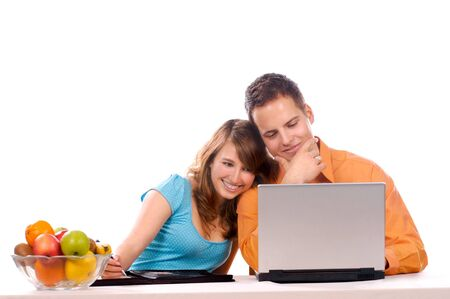 Beautiful Couple are haveing Fun With Laptop. photo