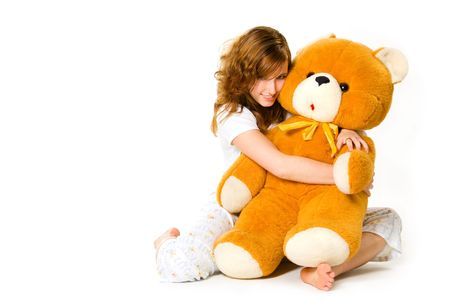 expressing: Young woman in pajamas with big teddy bear