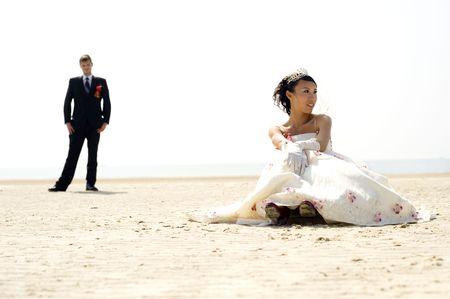 c�r�monie mariage: Les mari�s sur la plage d'Argent - Chine