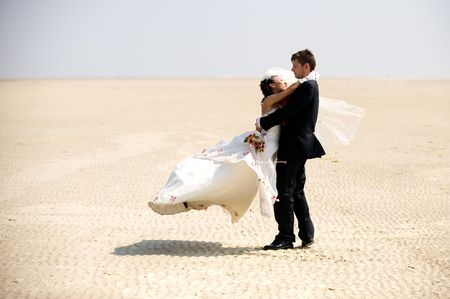 Bride and groom on Silver beach - China photo