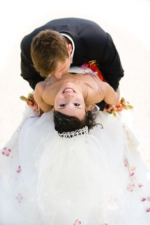Groom is Kissing His Bride on Chest photo