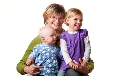 Happy grandmother with her granddaughters photo