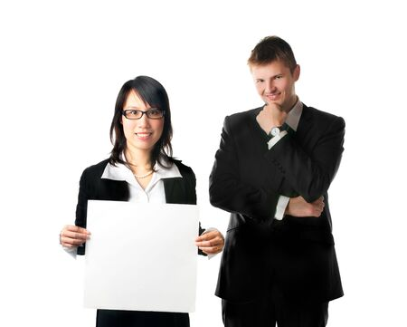 Smiling businesswoman and businessman looking at camera with blank sign on white background photo