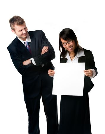 Smiling businesswoman and businessman with blank sign. Studio shot. Write something on a blank sign photo