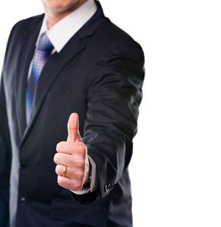 Satisfy businessman showing thumb up. Studio shot with copy space. photo