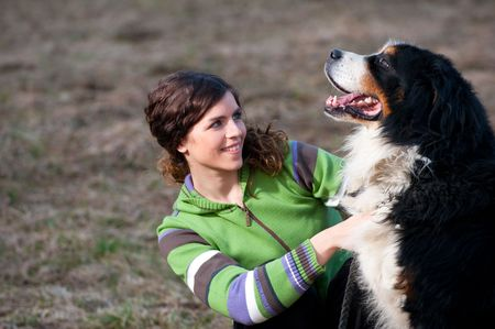 Beautiful young lady with her dog photo