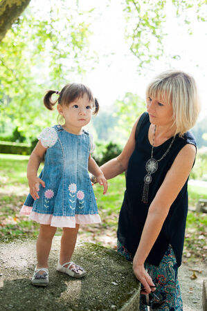 table skirt: Grandmother and her granddaughter in the park