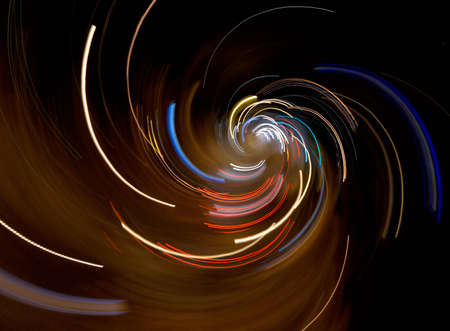 Abstract city lights composition: taken from aerial view of a night crossroad by fast camera movement. photo