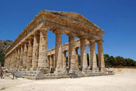 Summer sky in the Greek temple in Segesta (Sicily, Italy) photo