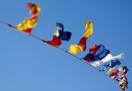 windy day: Nautical flags moving in a windy day