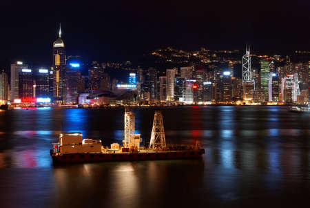 shipped: Small freight ship in Hong Kong at night Stock Photo