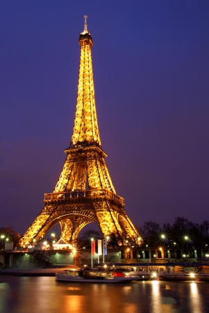 PARIS, FRANCE, 2 February 2009: Eiffel tower lit at twilight in Paris, France. The Eiffel tower is the most visited monument of France.