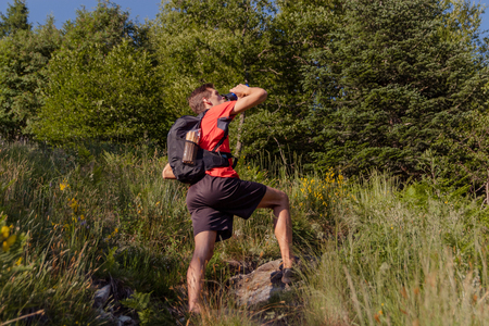 boy taking a break on a mountain trail
