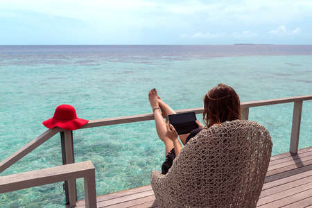 digital nomad concept. working in the maldives. Clear turquoise water as background