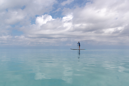 stand up paddle on calm turquoise water