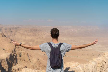 tourist enjoying freedom in the desert of israel. panoramic view