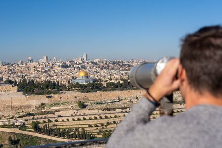 Man watching the Old City of Jerusalem from mount of olives 写真素材