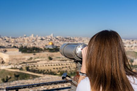 Woman watching the Old City of Jerusalem from mount of olives