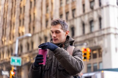 worker who is going to the office in new york while drinking coffee Stock Photo