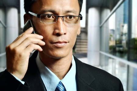 important phone call: Mature businessman on an important  business phone call