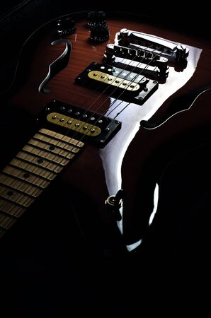 blues music: Artistic shot of a vintage  hollow  body electric guitar