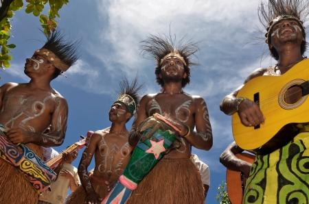 papua: Travel Photography of Local people from Raja Ampat, Papua, Indonesia performing traditional art and cultural dance.