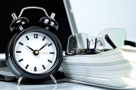 Conceptual shot of office work in relation with time efficiency. photo