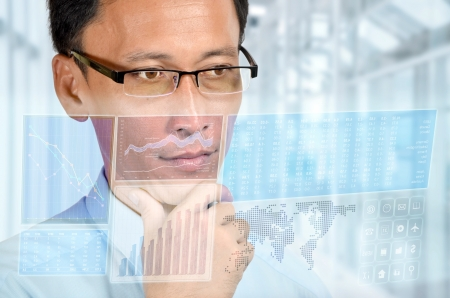 holographic: Businessman studying a digital business and financial report