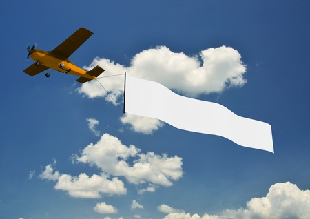 irplane banner pulled by airplane with beauriful sky background photo