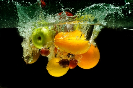 Fresh Fruit and Vegetables being  shot as they submerged under water. So fresh and delicious. This idea can also be use to show washing food before being process further. Stock Photo