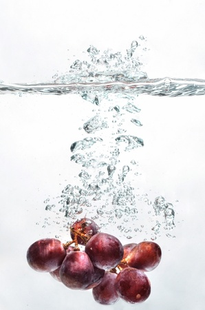 dramatically: Grape fruit picture taken as they submerged dramatically into a clean water  Stock Photo