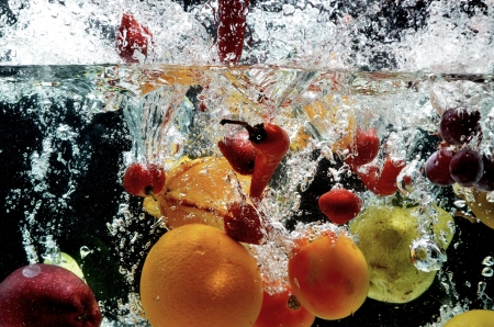 strawberry splash: Various fresh and healthy fruit picture taken as they submerged dramatically into a clean water