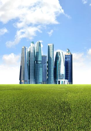 corporate building: Futuristic city background with green  environmental friendly grassland foreground Stock Photo
