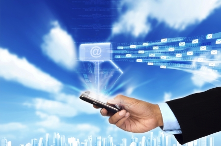 A concept of Businessman checking his email box from inside his smart phone Stock Photo - 15881602