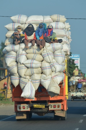 sack truck: A unique photos of an overloaded truck carrying rice from the mill to the market Editorial