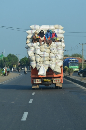 A unique photos of an overloaded truck carrying rice from the mill to the market