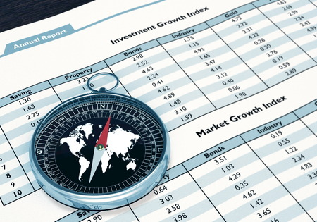 A conceptual image for business, investment and finance with Compass on top of Financial report Stock Photo - 23007804
