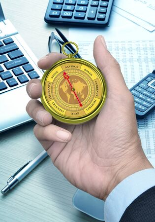 A  conceptual image for financial and business genre  A compass that can show you the money and the profit with a businessman hand holding it  Foto de archivo
