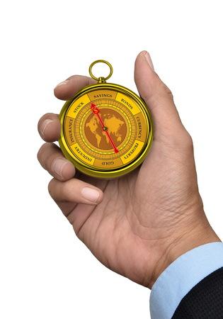 Een conceptueel beeld voor financiële en zakelijke genre Een kompas dat je kunt laten zien het geld en de winst met een zakenman hand vast te geïsoleerd in het wit