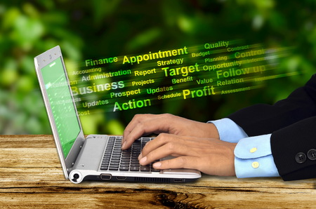 work from home: A businessman doing his job with  an internet connected laptop with a green background  Can be use for work from home concept