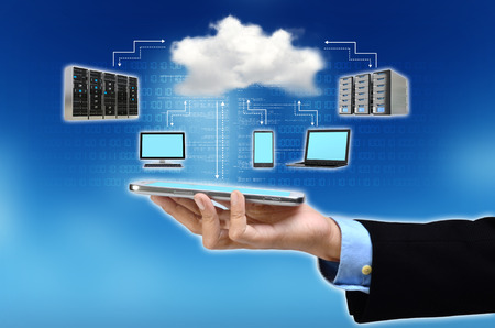 A businessman hand showing the concept of cloud computing internet technology in his hand Imagens - 30574095