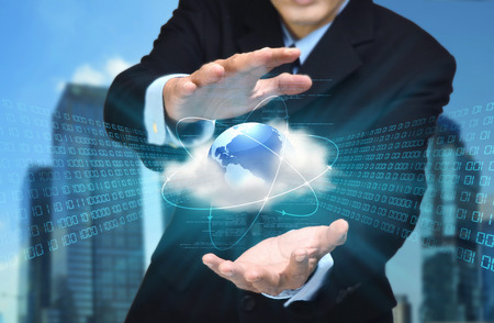 A businessman hand showing the concept of cloud computing internet technology in his hand Imagens - 30574098