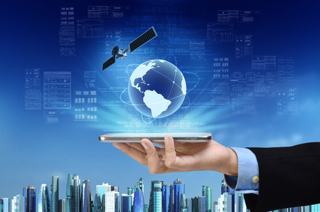 A concept of global internet connection on a smart phone with futuristic city background