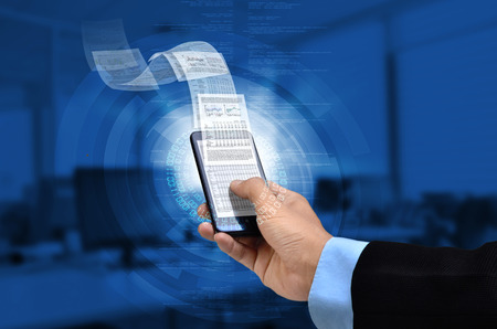 spread sheet: Businessman reading business or financial report on smart phone concept via internet connection Stock Photo
