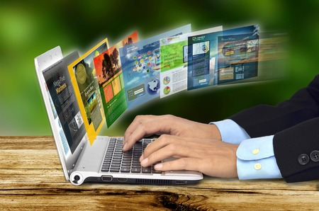 page: Businessman hand browsing internet websites on his laptop Stock Photo