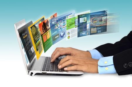 web site: Businessman hand browsing internet websites on his laptop Stock Photo
